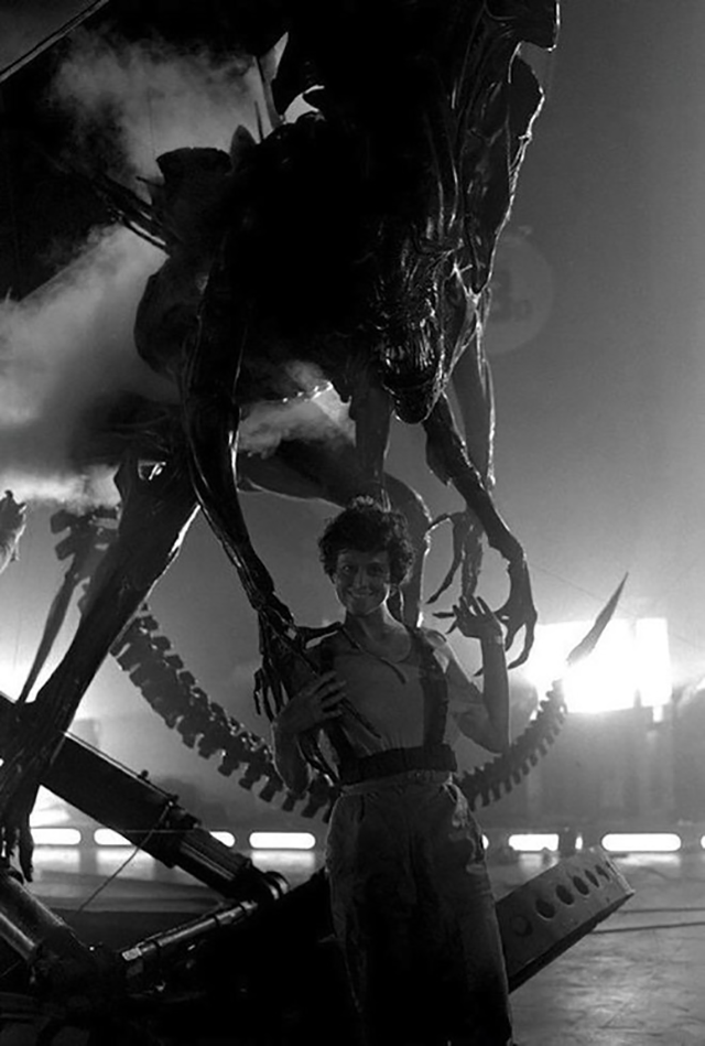 Sigourney Weaver as Ripley, posing with the alien queen from the sci-fi movie Aliens