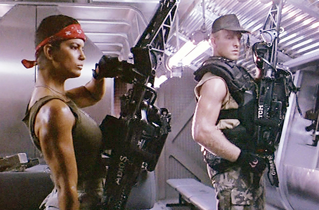 Vasquez and Drake, two characters from James Cameron's sci-fi movie Aliens