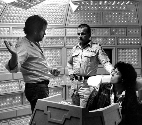 An image of Ridley Scott, Ian Holm and Sigourney Weaver from the sci-fi film Alien